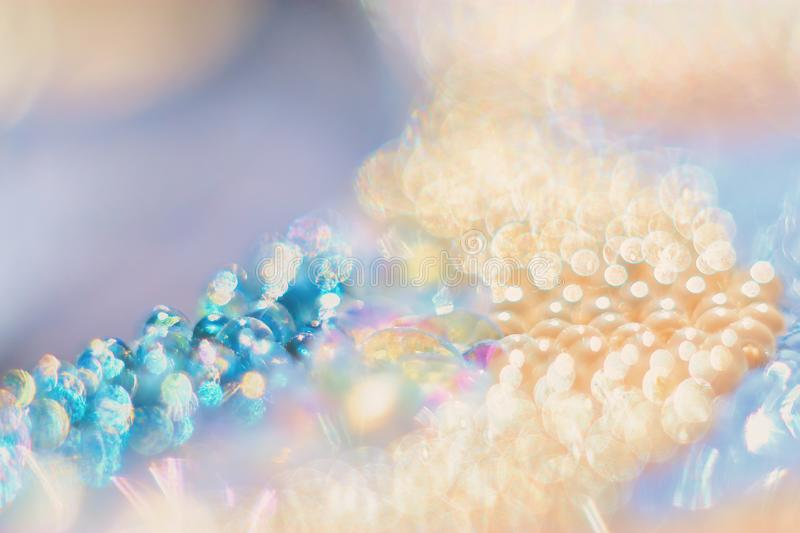 Bead with gentle abstract bokeh background. Macrophotography bead with gentle abstract bokeh background stock image