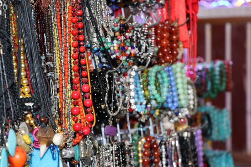 Bead necklace or rosary, threading from a rounded small piece of stone and silver material. Hang a lot to sell as souvenirs stock photos