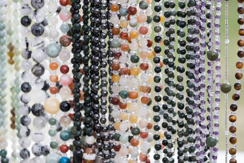 Bead necklaces on display in a bead shop royalty free stock photography