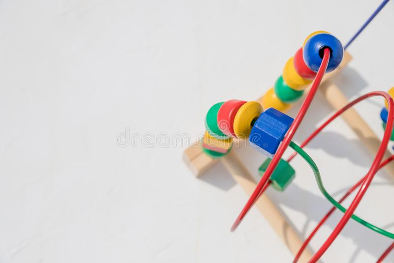 Bead roller coaster toy for child development, Logical thinking or problem solving.colorful bead maze toy. Fun and. Bead roller coaster toy for child development royalty free stock images