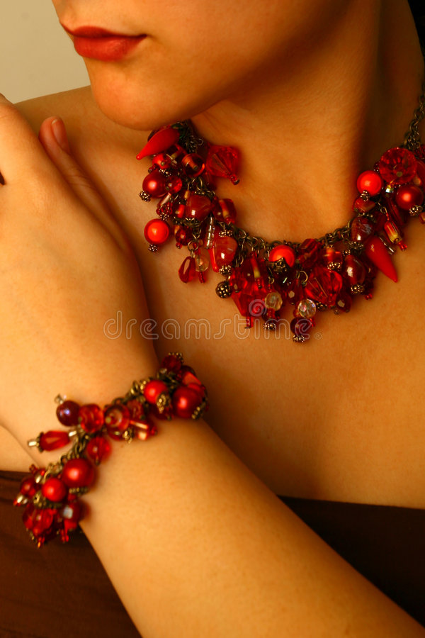 Beaded Jewels. Woman with red beaded jewelry on