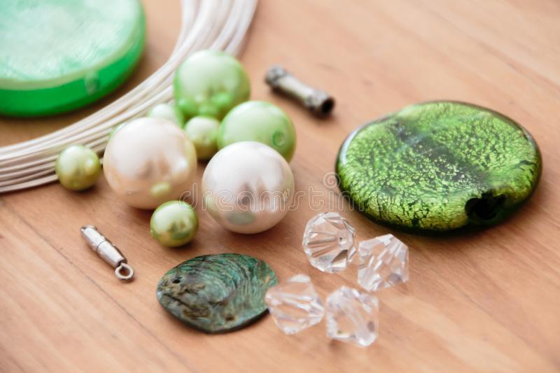 Beading set to make yourself. Green beading set to make yourself royalty free stock photography