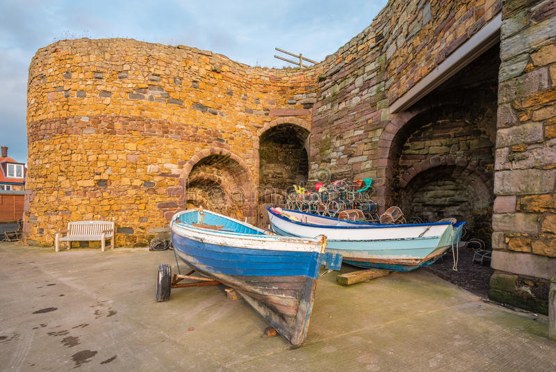 Beadnell Lime Kilns and fishing boats. Beadnell is a village on the Northumberland coastline, with a small fishing harbour set into Beadnell Bay. Disused stock image