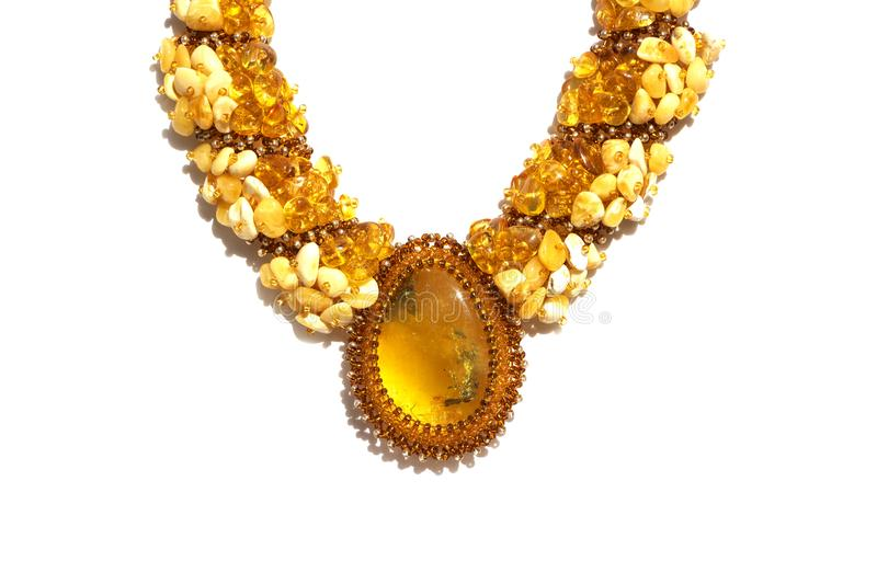 Beads with amber, brooch, bright colorful pieces of amber.  stock photo