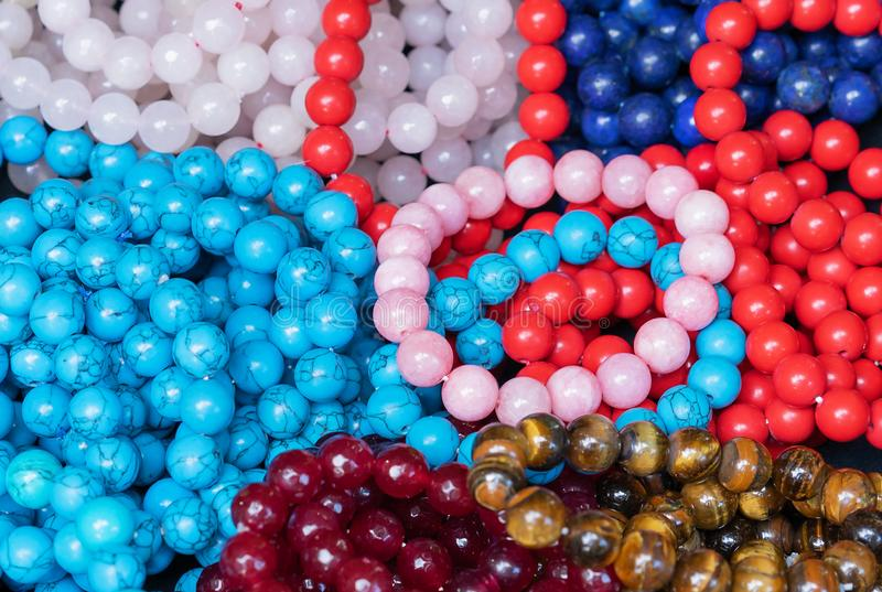 Beads and bracelets made of natural stones. Products from semiprecious stones royalty free stock photography