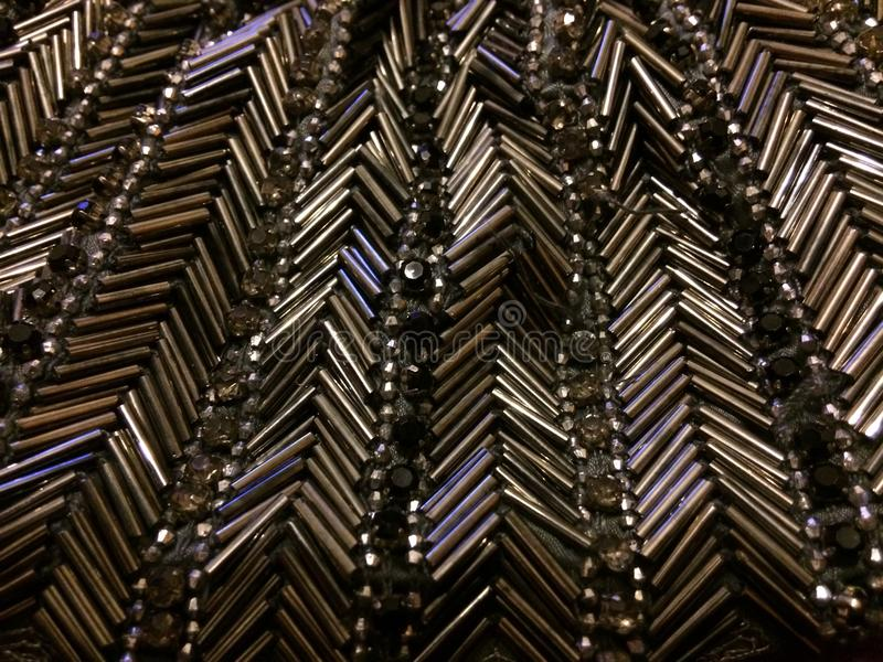 Beads. Grey bugle beads stitched in a chevron pattern stock image