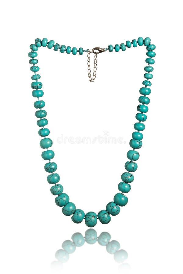 Turquoise necklace isolated on white background royalty free stock photo