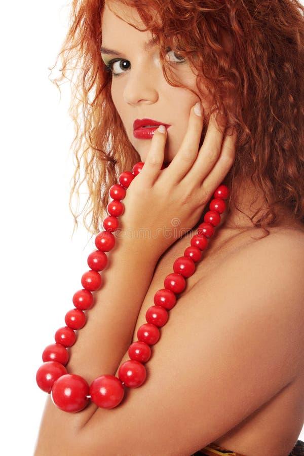 beads rött trä royaltyfri fotografi