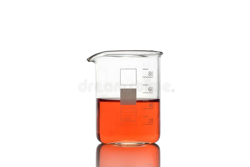 Beaker with red liquid on white background stock photos