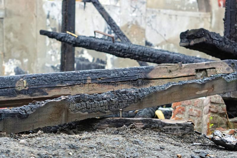 Beam fire damage. Wooden beam fire damage black stock photography