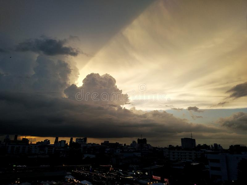 The beam of light, the dark cloud and cities in the shadow. The beam of light behide the dark cloud and cities in the shadow stock images
