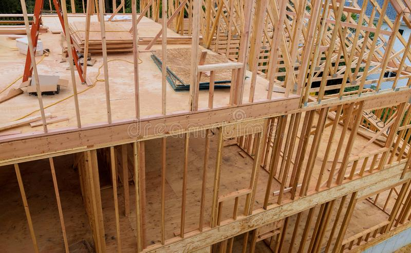 Beam stick built frame of a new house under construction stock photo