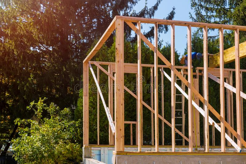 Beam stick built frame of a new house under construction stock image