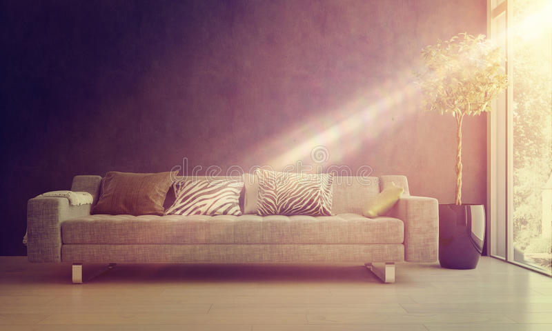 Beam of sunlight on a comfy sofa. Bright glowing beam of sunlight falling on a comfy sofa and potted tree in a homely living room interior royalty free stock photography