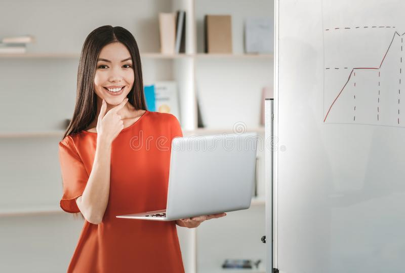 Beaming beautiful finance specialist working really hard stock image