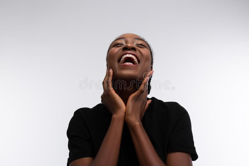 Beaming cute African-American woman laughing out loud stock photos