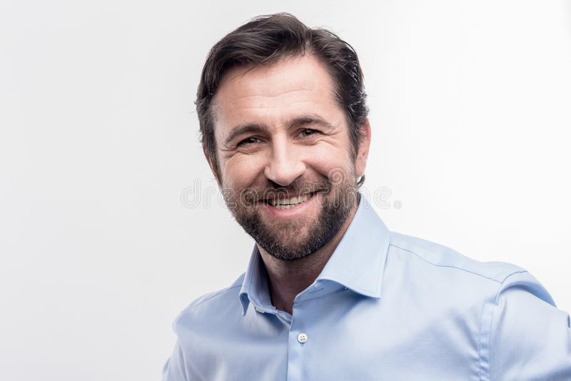 Beaming prosperous businessman feeling happy after business meeting royalty free stock image
