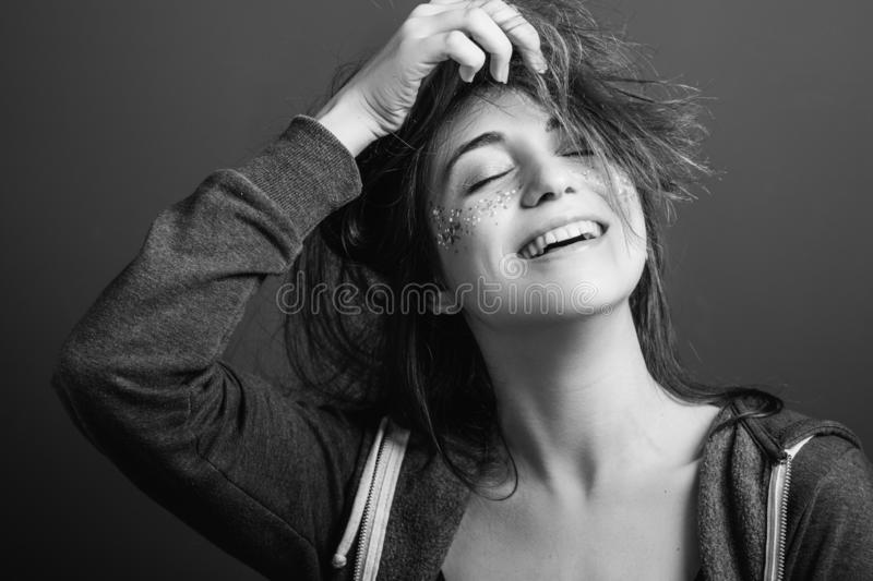 Beaming young woman youth beauty playful mood stock images