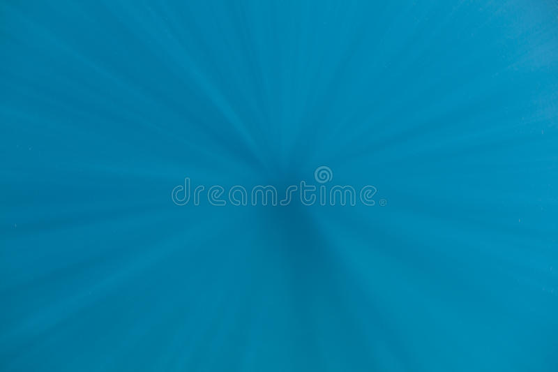 Beams of Light Descending Into Blue Water stock photo