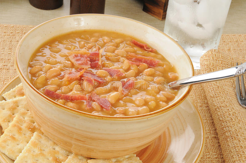 Bean and bacon soup with crackers stock photo