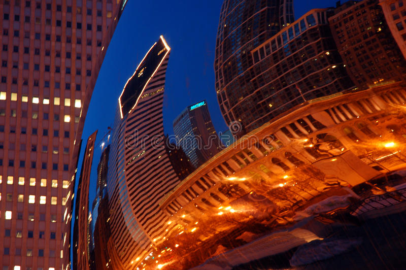 Bean refelctions. The skyline of Chicago is reflected in the Cloud Gate Sculpture, better known as the Bean royalty free stock image