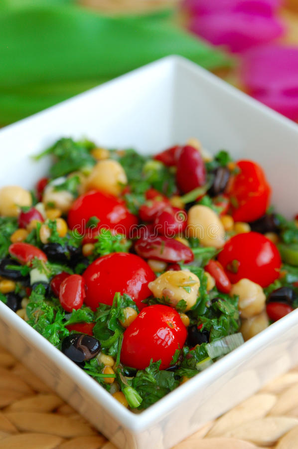 Bean salad. Fresh bean salad in a white bowl stock photography