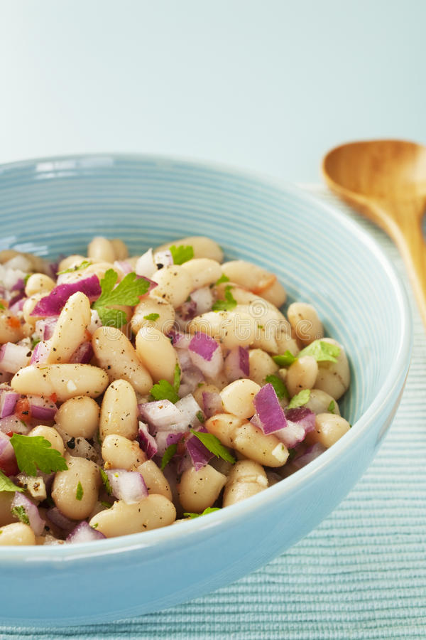 Bean Salad. Italian cannelini bean salad of beans in lemon vinaigrette with red onion, rosemary, parsley and garlic stock images