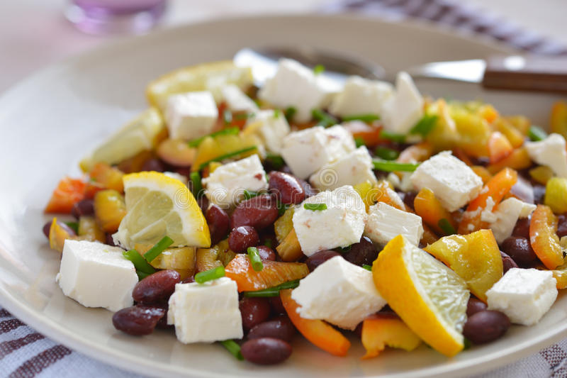 Bean salad. With feta cheese, pepper, chives, and lemon stock images