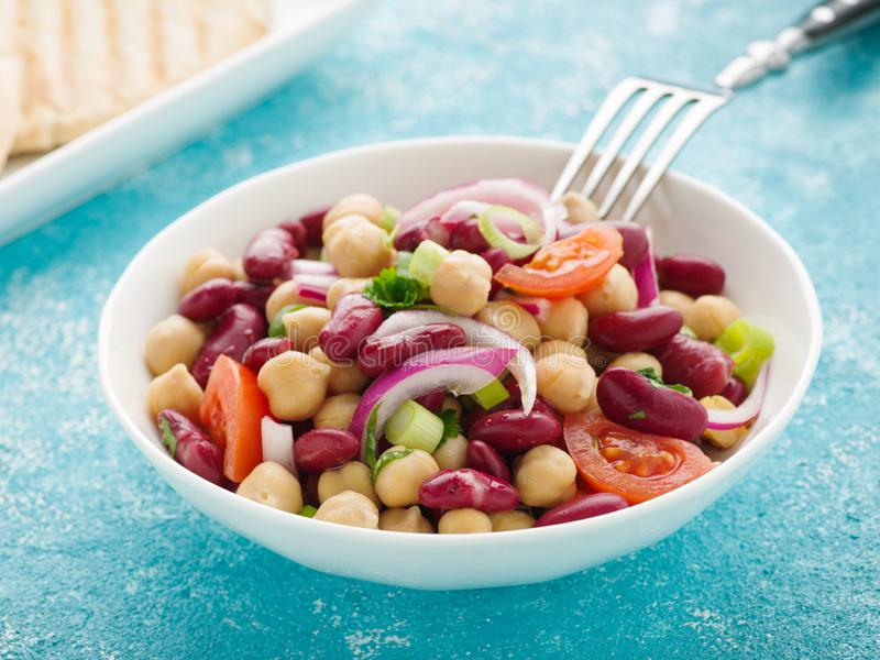Bean salad. Tasty bean salad with chick peas, kidney beans and tomatoes stock image