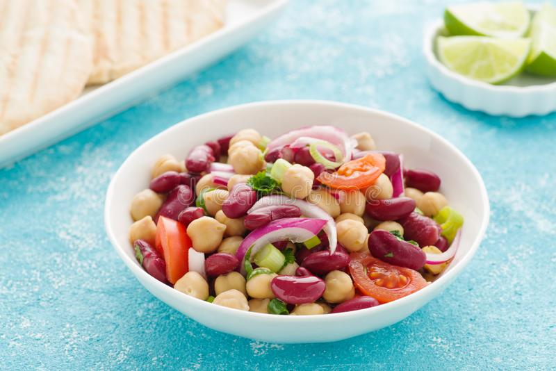 Bean salad. Tasty bean salad with chick peas, kidney beans and tomatoes royalty free stock image