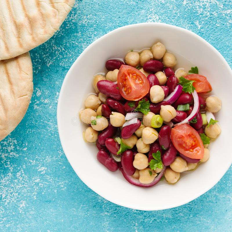Bean salad. Tasty bean salad with chick peas, kidney beans and tomatoes stock photo
