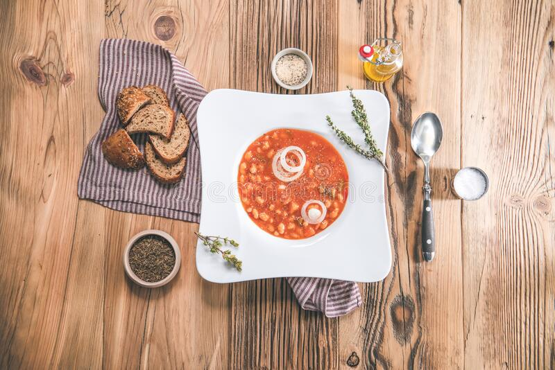 Bean soup in bowl on wooden table. Delicious lunch royalty free stock images