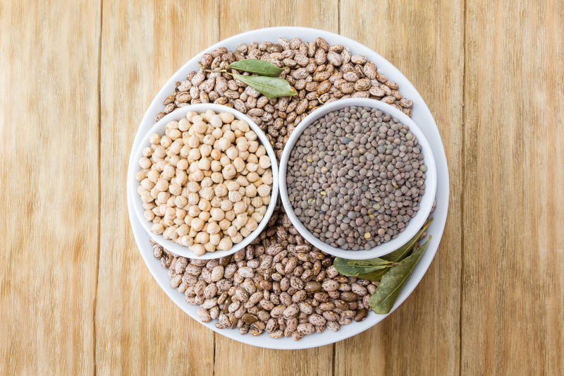 Beans, chickpeas and lentils in bowls stock photography