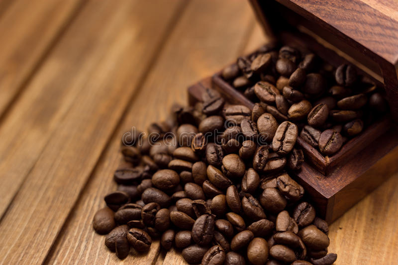 Beans coffee. And wooden box royalty free stock images