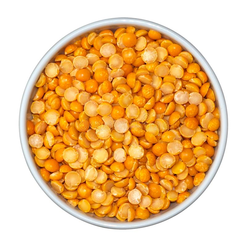 Beans of dry yellow split peas Eidaho in white bowl isolated on white background. Top view royalty free stock images