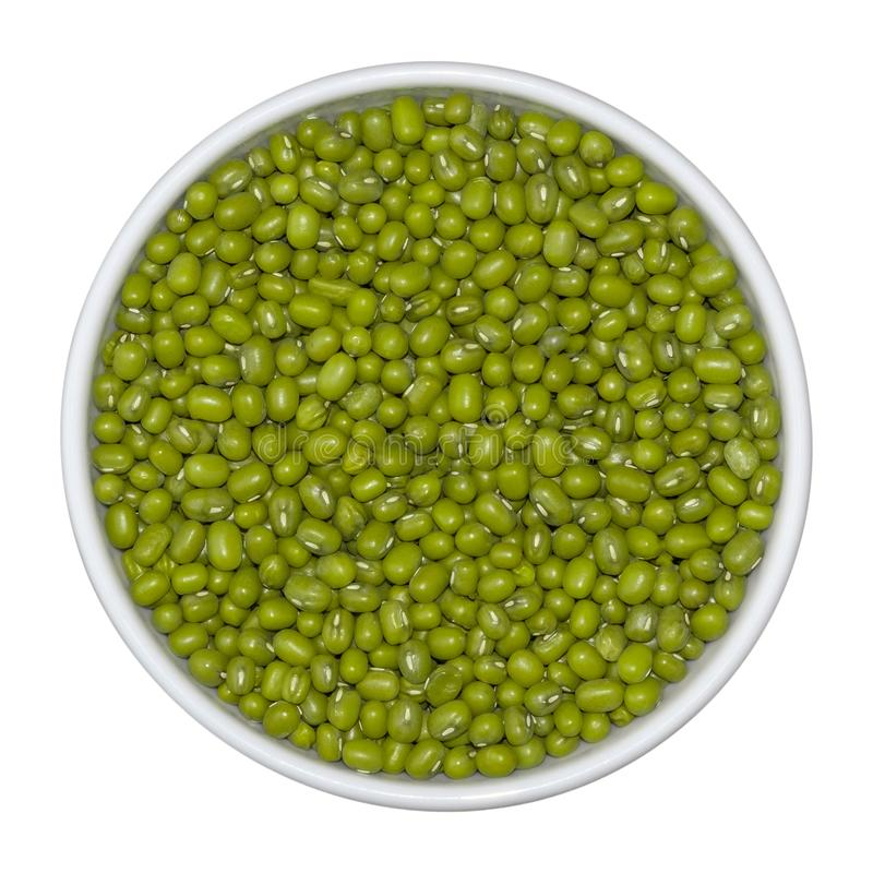 Beans of green mung in white bowl on isolated on white background. Top view royalty free stock photography