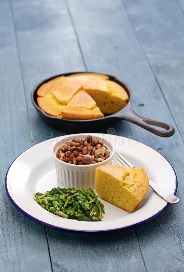 Beans and greens with cornbread, southern cooking. Beans and greens with cornbread, cuisine of the Southern United States royalty free stock photos