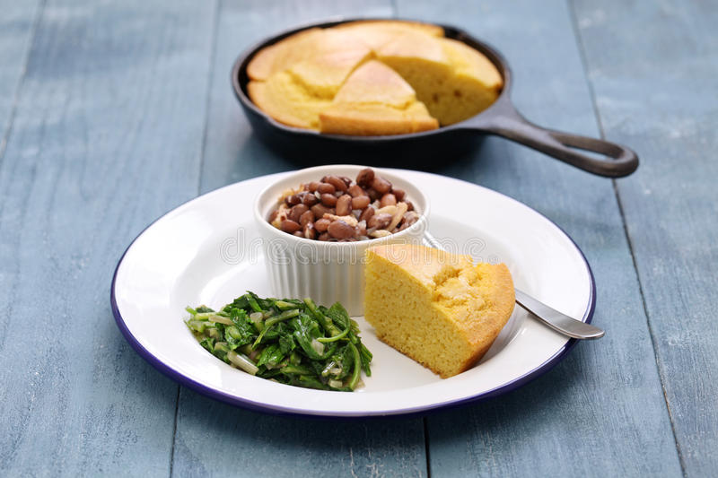 Beans and greens with cornbread, southern cooking. Beans and greens with cornbread, cuisine of the Southern United States stock images