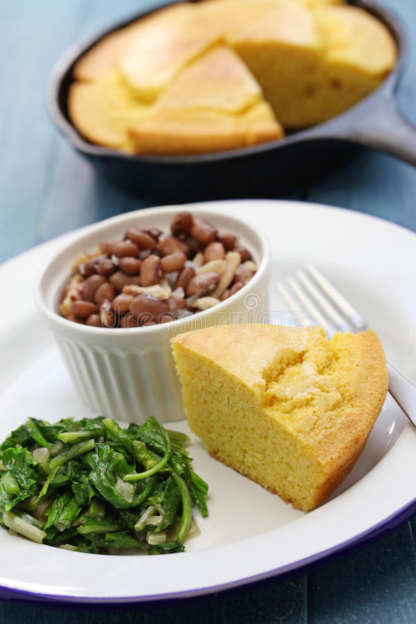 Beans and greens with cornbread, southern cooking. Beans and greens with cornbread, cuisine of the Southern United States royalty free stock photo
