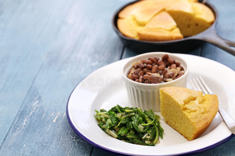 Beans and greens with cornbread, southern cooking. Beans and greens with cornbread, cuisine of the Southern United States royalty free stock images