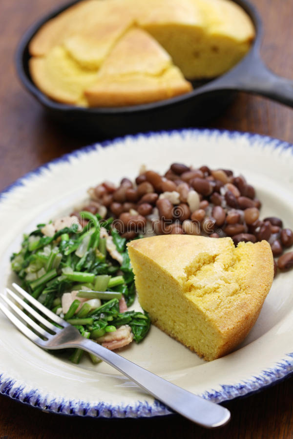 Beans and greens with cornbread, southern cooking. Beans and greens with cornbread, cuisine of the Southern United States royalty free stock image