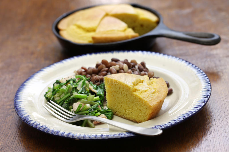 Beans and greens with cornbread, southern cooking. Beans and greens with cornbread, cuisine of the Southern United States stock photos