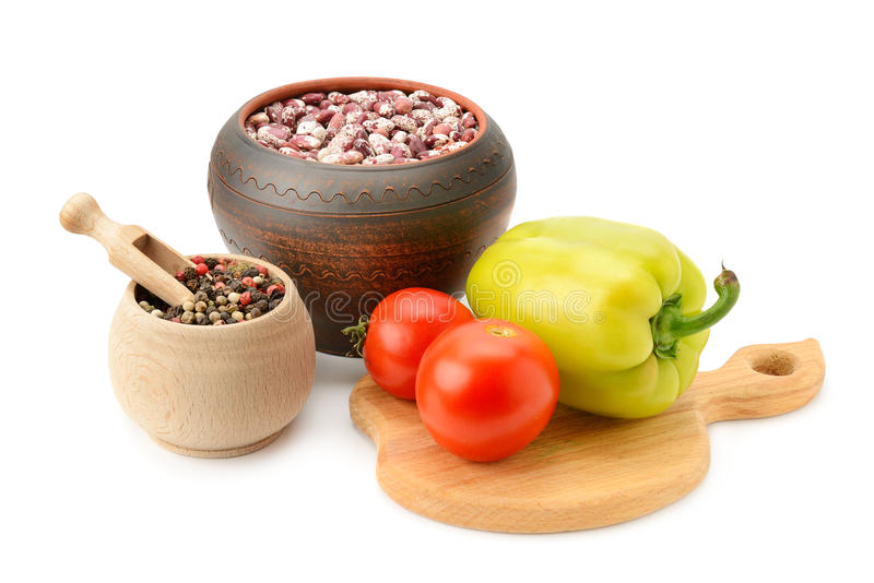 Beans in pot and vegetables royalty free stock image