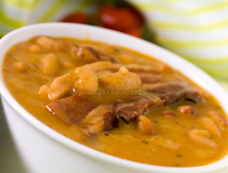 Beans and roasted pork bacon with chili pepper stock photography