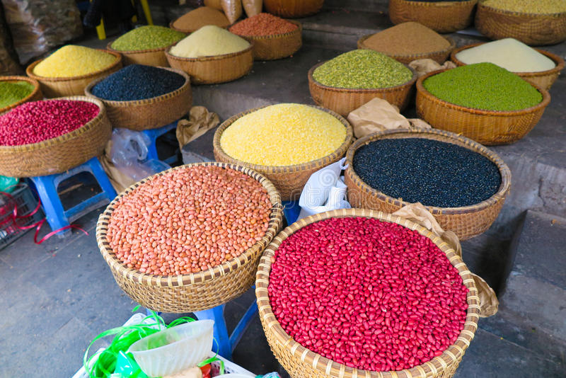 Beans sold in the vietnamese market. Colourful beans and other legumes sold in the market in Vietnam stock image