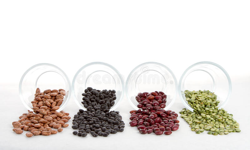 Download Beans And Split Peas Spilling Out Of Glass Jars Stock Photo - Image of beige, kidney: 23549536
