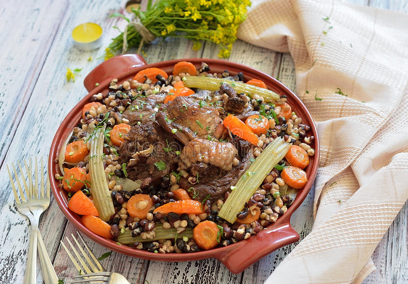 Beans with vegetables and meat on a plate royalty free stock images