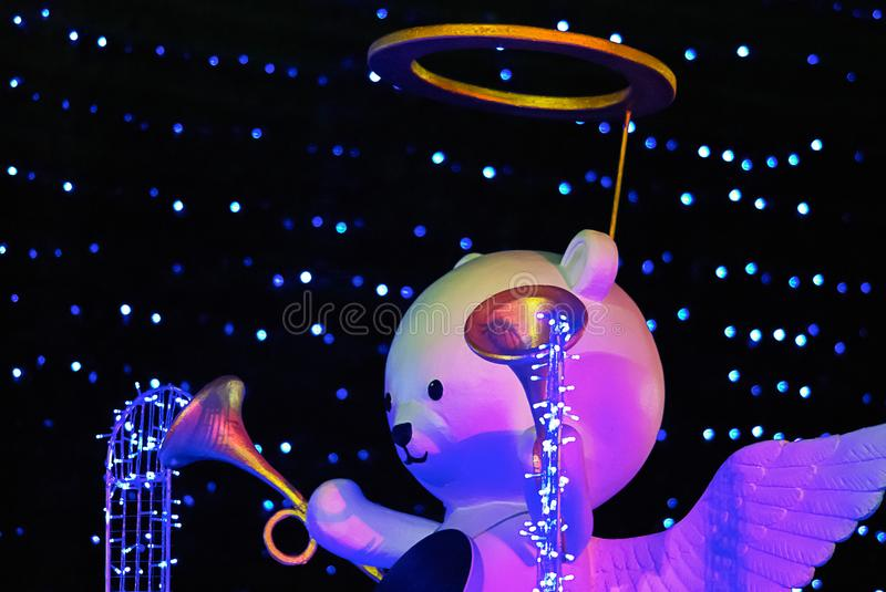 Bear angle doll with trumpet, Christmas decoration stock photography