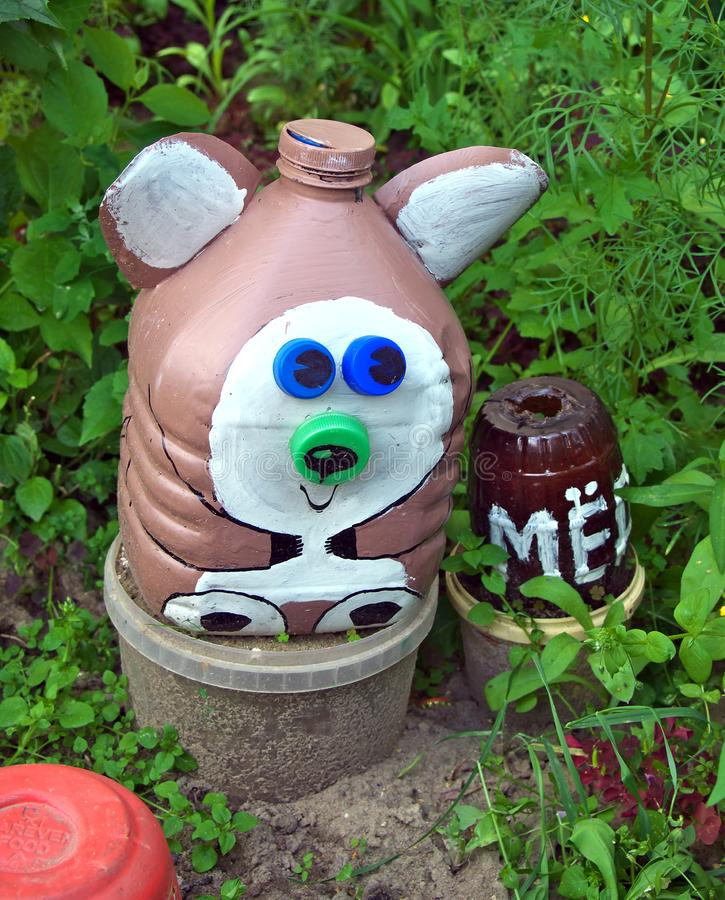 Bear with a barrel of honey, made from old used plastic bottles royalty free stock photos