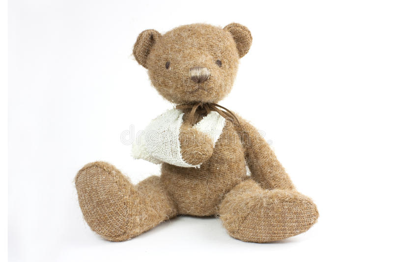 Bear broken arm. Cute teddy bear with a broken arm in a sling stock photos
